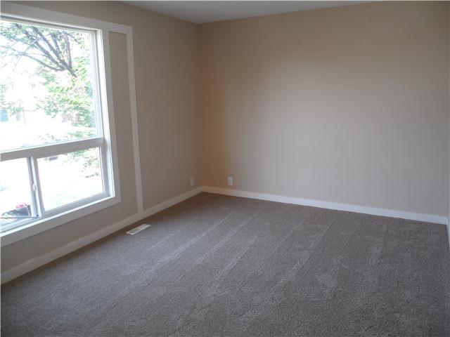 Photo 4: 41 FONDA Crescent SE in Calgary: Fonda Residential Attached for sale : MLS(r) # C3646765