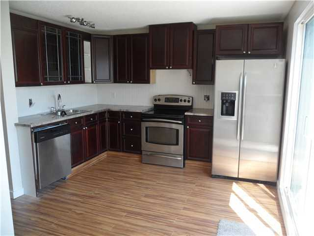 Photo 7: 41 FONDA Crescent SE in Calgary: Fonda Residential Attached for sale : MLS(r) # C3646765