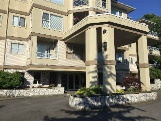 "Main Photo: 202 20120 56 Avenue in Langley: Langley City Condo for sale in ""BLACKBERRY LANE"" : MLS® # R2186162"