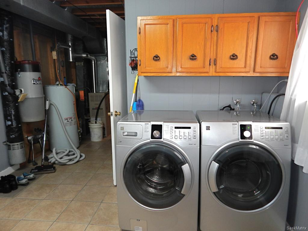 Laundry area and mechanical. High efficient furnace is newer