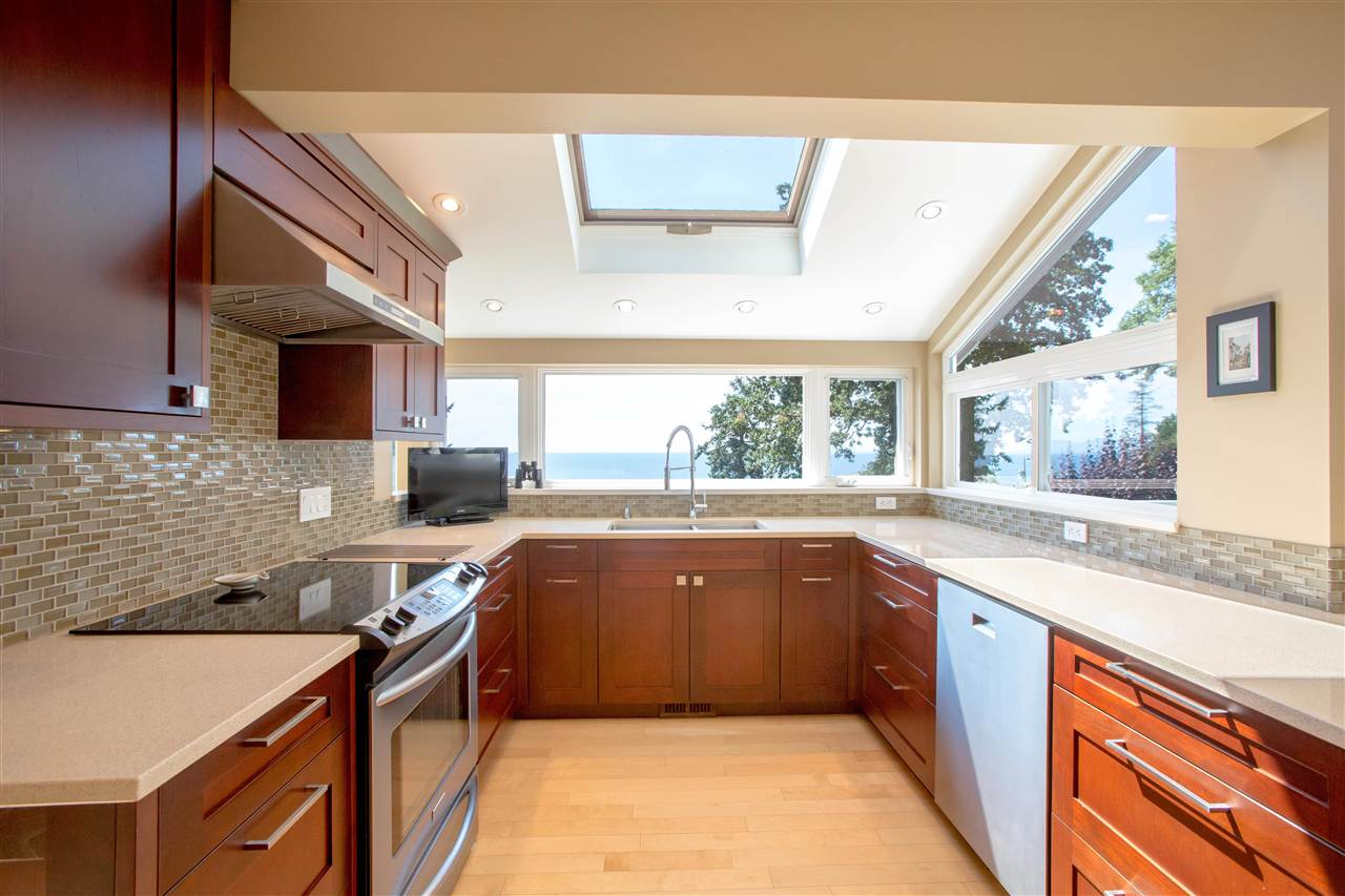 Whether preparing a meal or cleaning up after, you won't get tired of this kitchen and the views.  Lots of storage and counter-space.  Gas available behind stove.