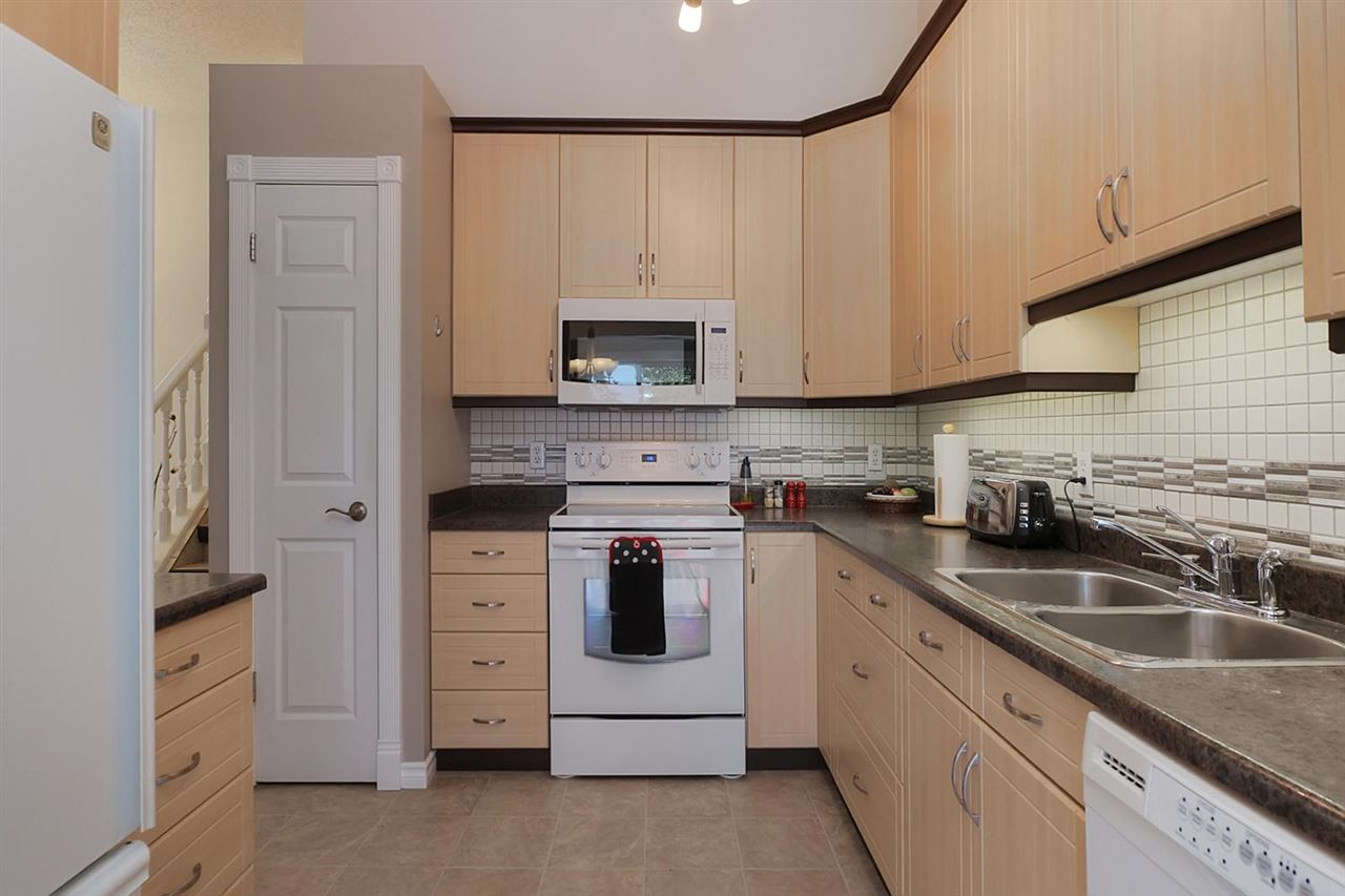 This photo of the kitchen shows off the location of the pantry. The stove has a ceran top. There is plenty of cabinets space and counter space. You will enjoy being able to create great meals here and will love the organization options.