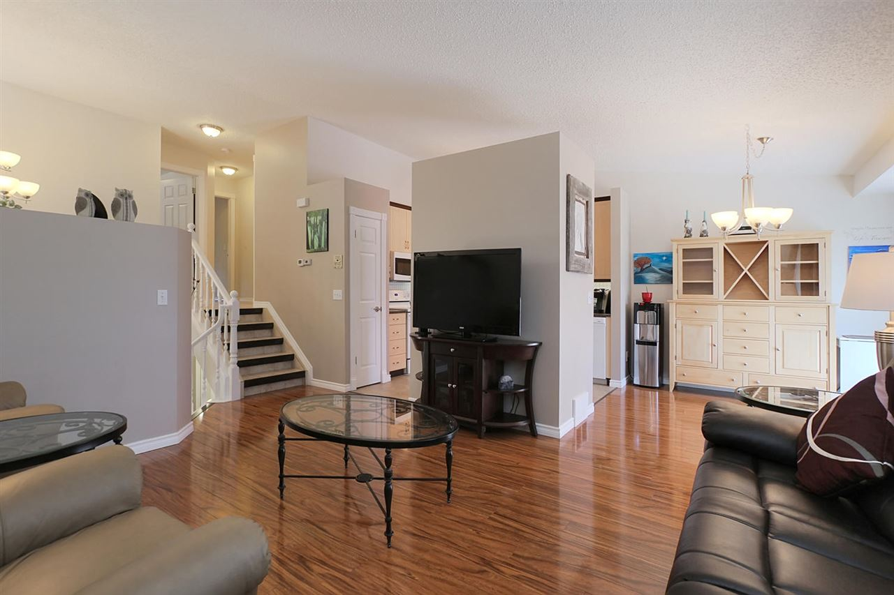 You can clearly see the nice flow on the main floor of this condo here. Note the updates of higher baseboards and wider trims, the new paint, the new lighting and the new laminate flooring. There will be nothing to do except move in and enjoy life.