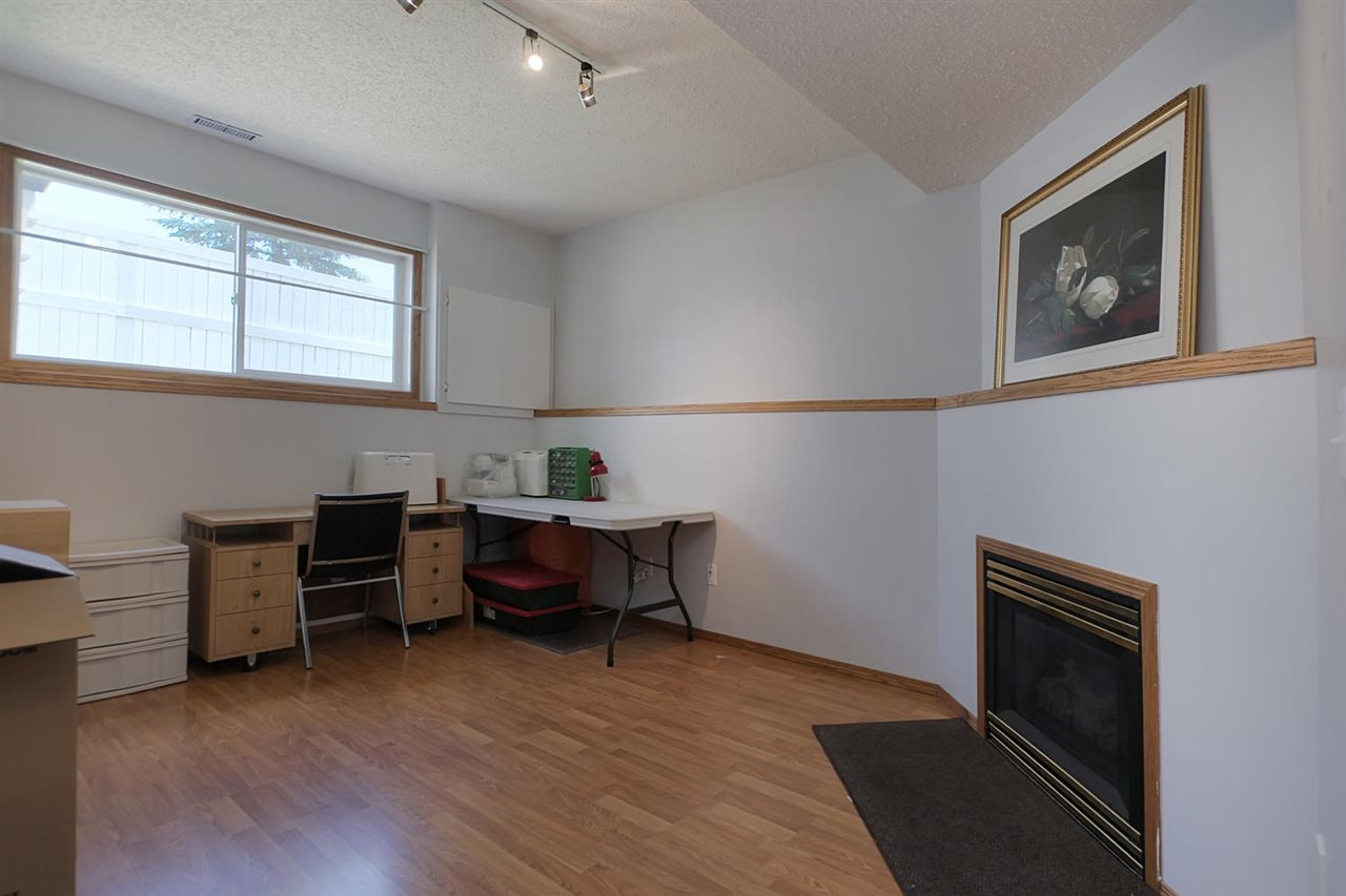 This family room is on the lower level and just a few steps down from the entrance level or even less from the garage. The fireplace makes it cozy, the laminate floor makes it easy care.The paint is being done asap to cover damage from a dart board.