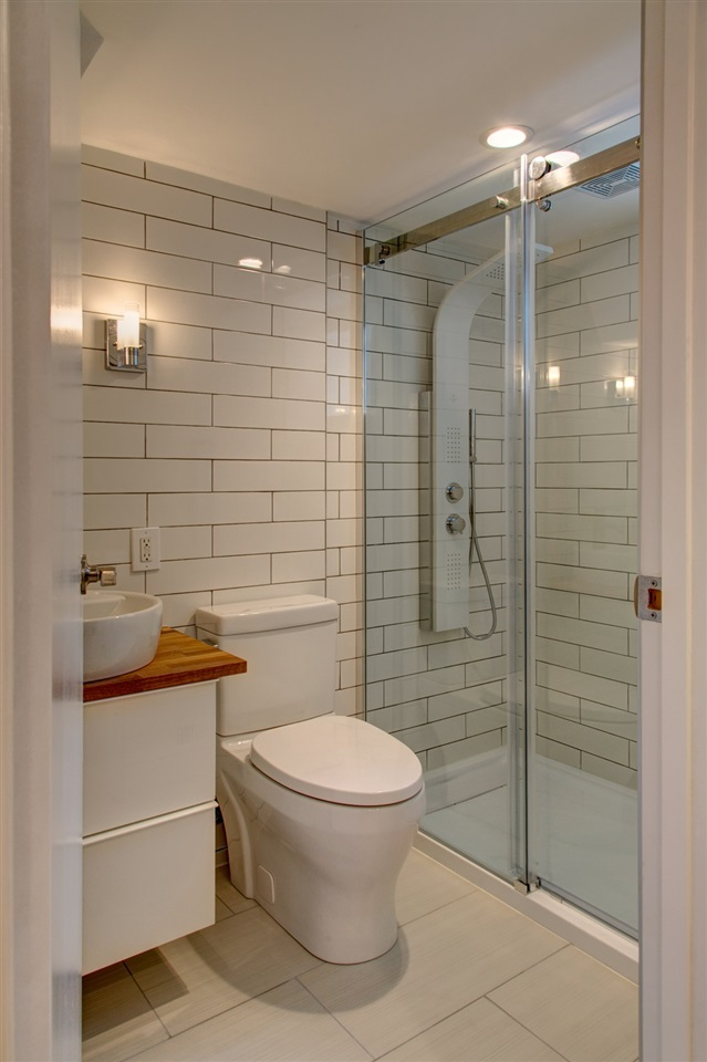 Basement bath is totally redone in modern subway tile