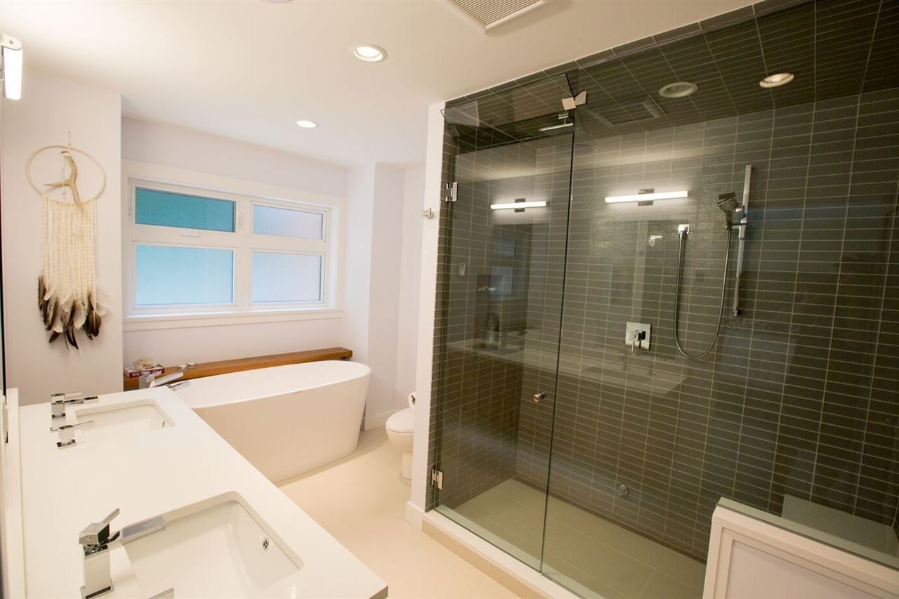 Steam shower for two as well as stone soaker tub...heated floors and shower seat.