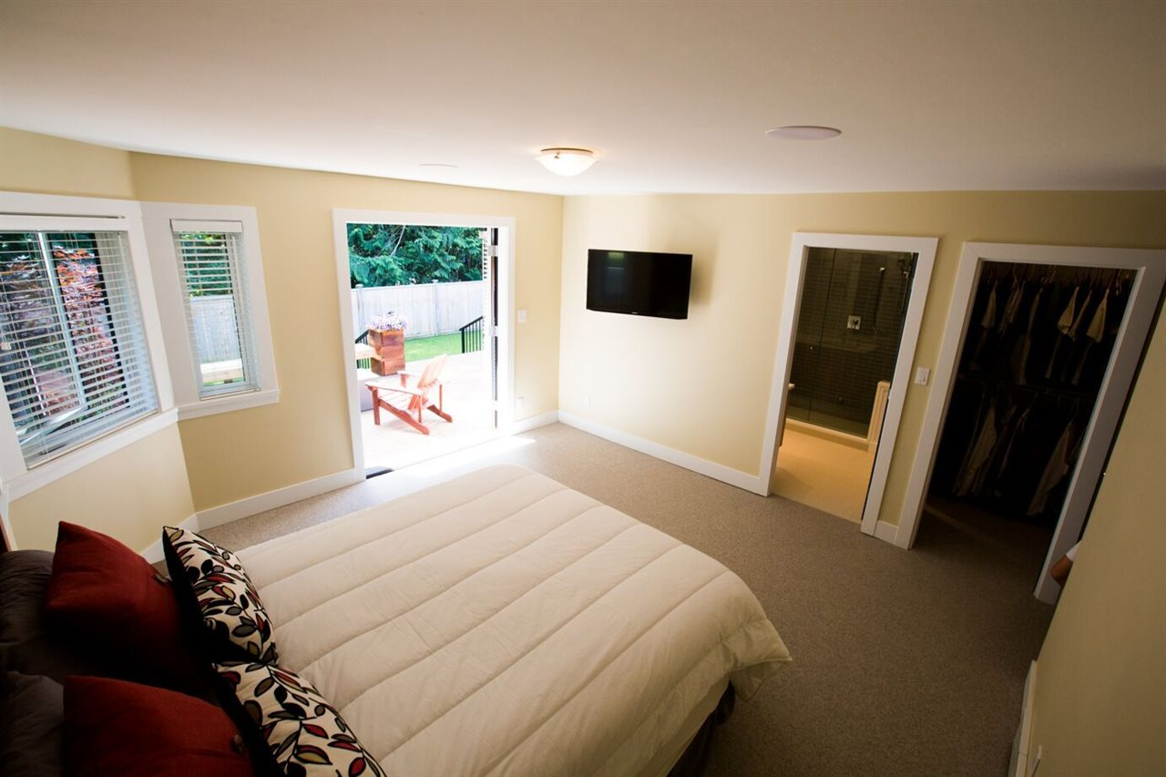 with french door to deck , walk in closet and sumptuous ensuite