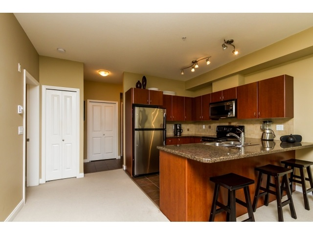 "Photo 3: 311 2346 MCALLISTER Avenue in Port Coquitlam: Central Pt Coquitlam Condo for sale in ""THE MAPLES AT CREEKSIDE"" : MLS(r) # R2065031"
