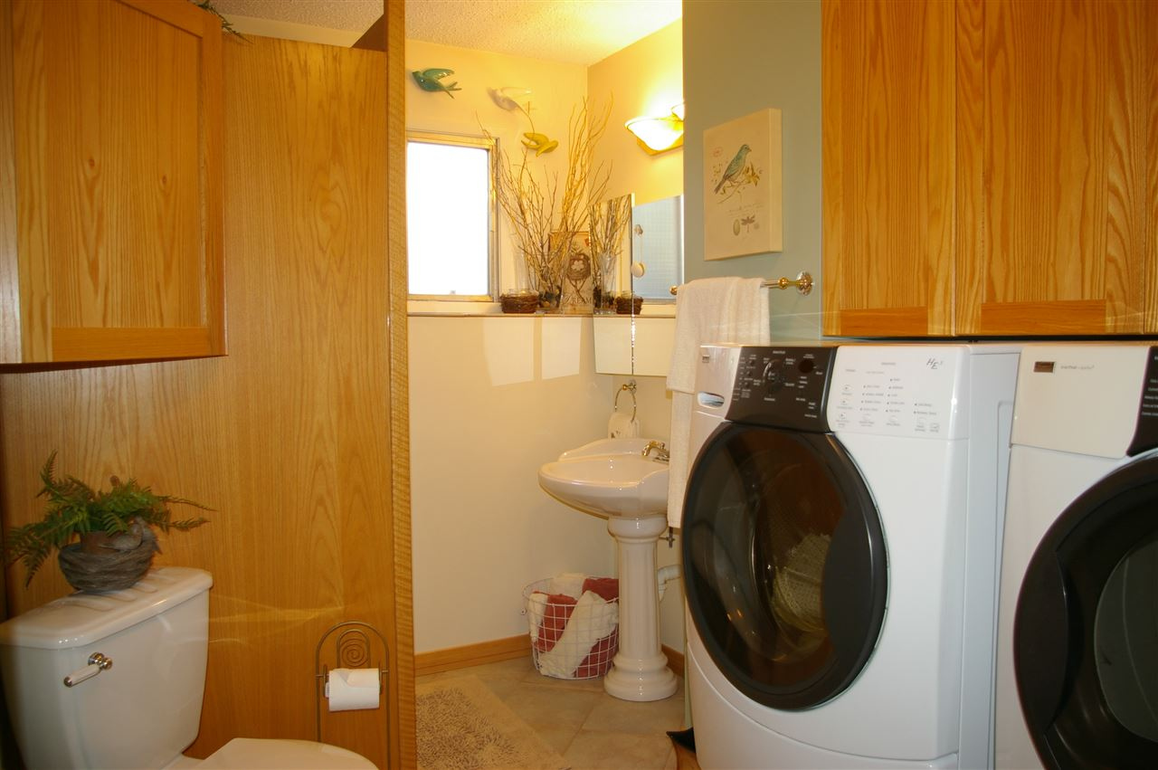 Okay, either the three piece bath has a washer/dryer in it, or the laundry room features a three piece bath in it...