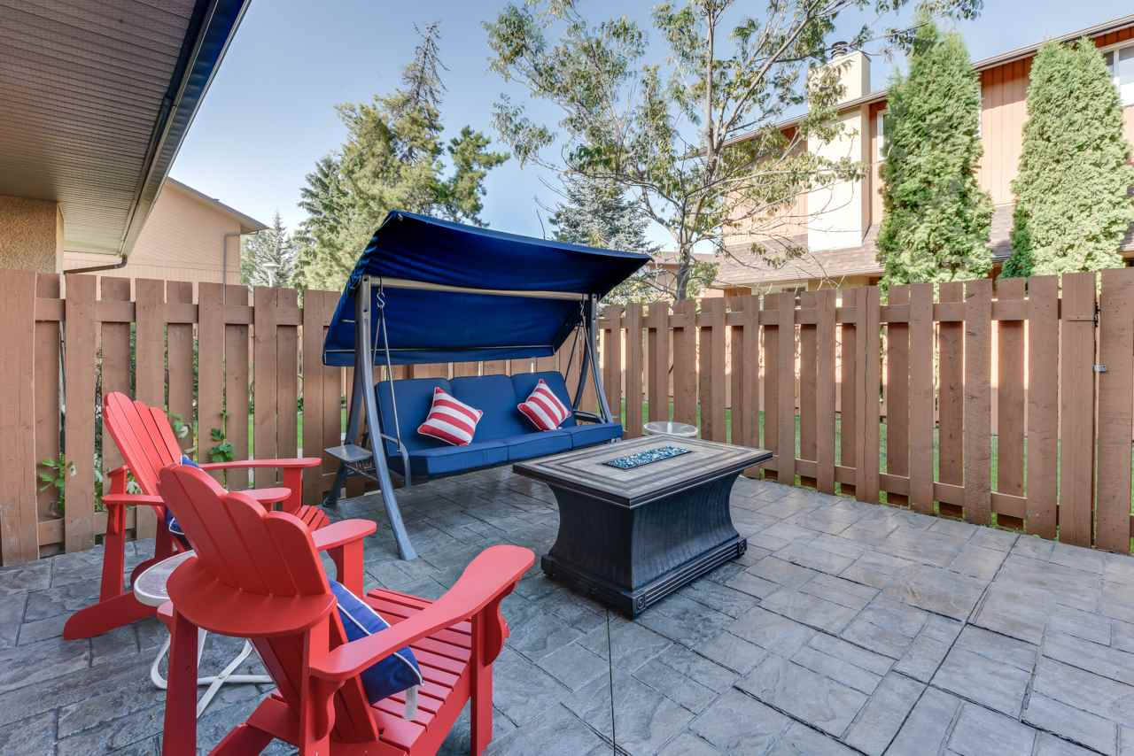 Enjoy evenings on this private, fenced patio with cobblestone patterned stamped concrete! Extravagant - yes! But you deserve it!