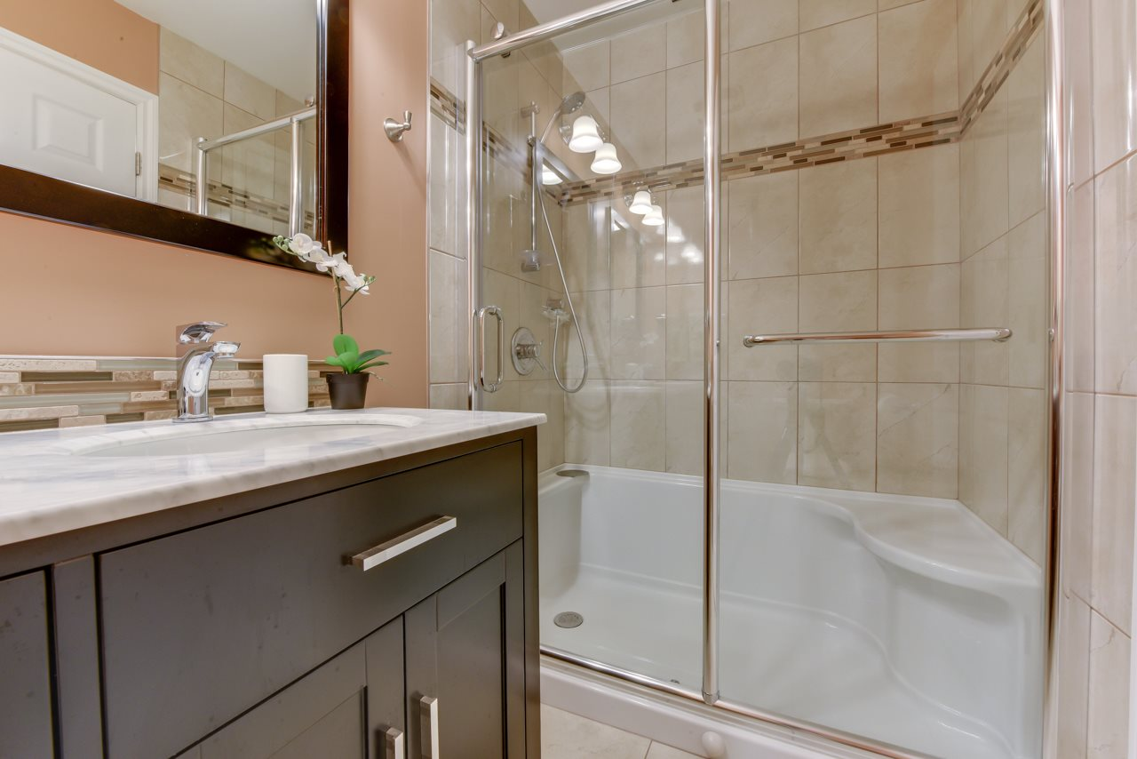 Gorgeous reno on this main bathroom with spacious shower, double sinks in new vanity, new tile floors and Smart Home Auto fan sensor