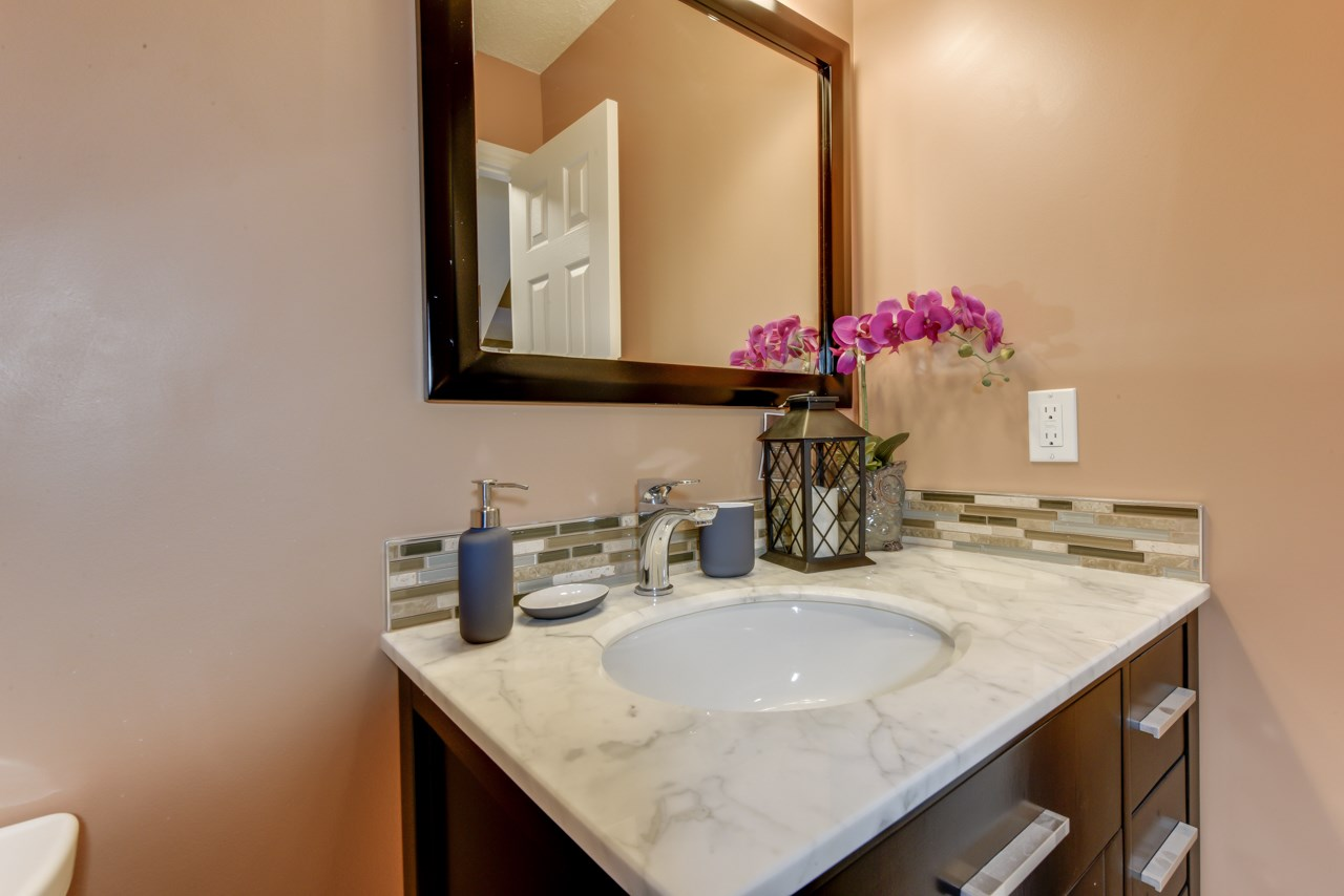 2 piece powder room has all new fixtures, plumbing, towel rack/grab bar
