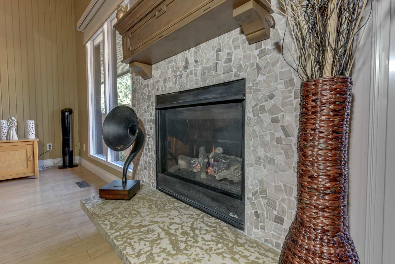New Stone-fronted gas fireplace with remote start and circulating fan with thermostat control