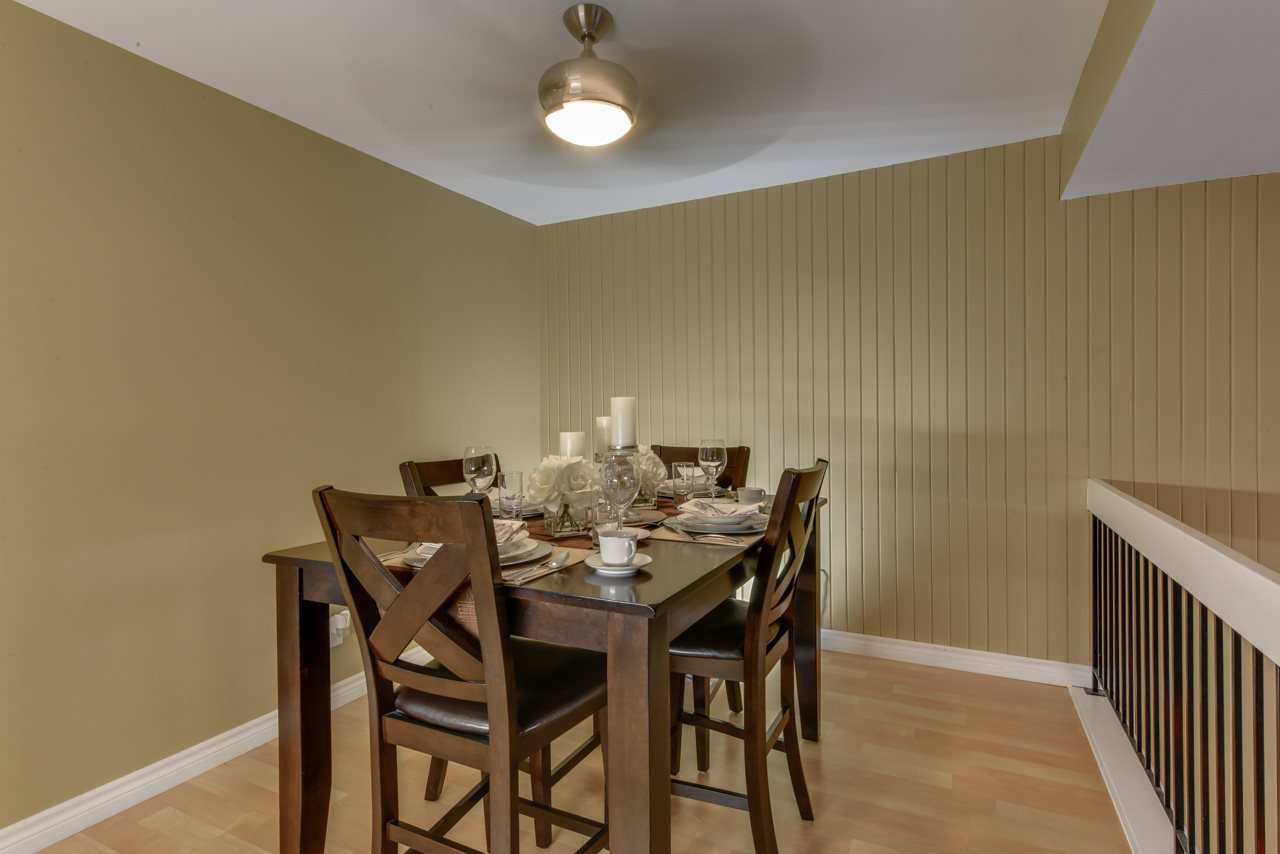 Large dining room overlooking the living room can handle all your gatherings and features new ceiling fan/light and laminate flooring.