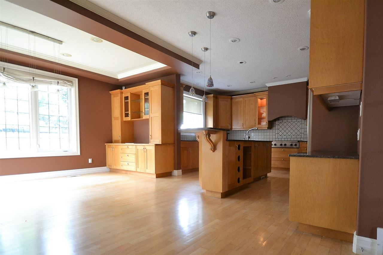 Solid wood cabinets and built-ins. Bay window to rear yard. Kitchen/Dinette combo.