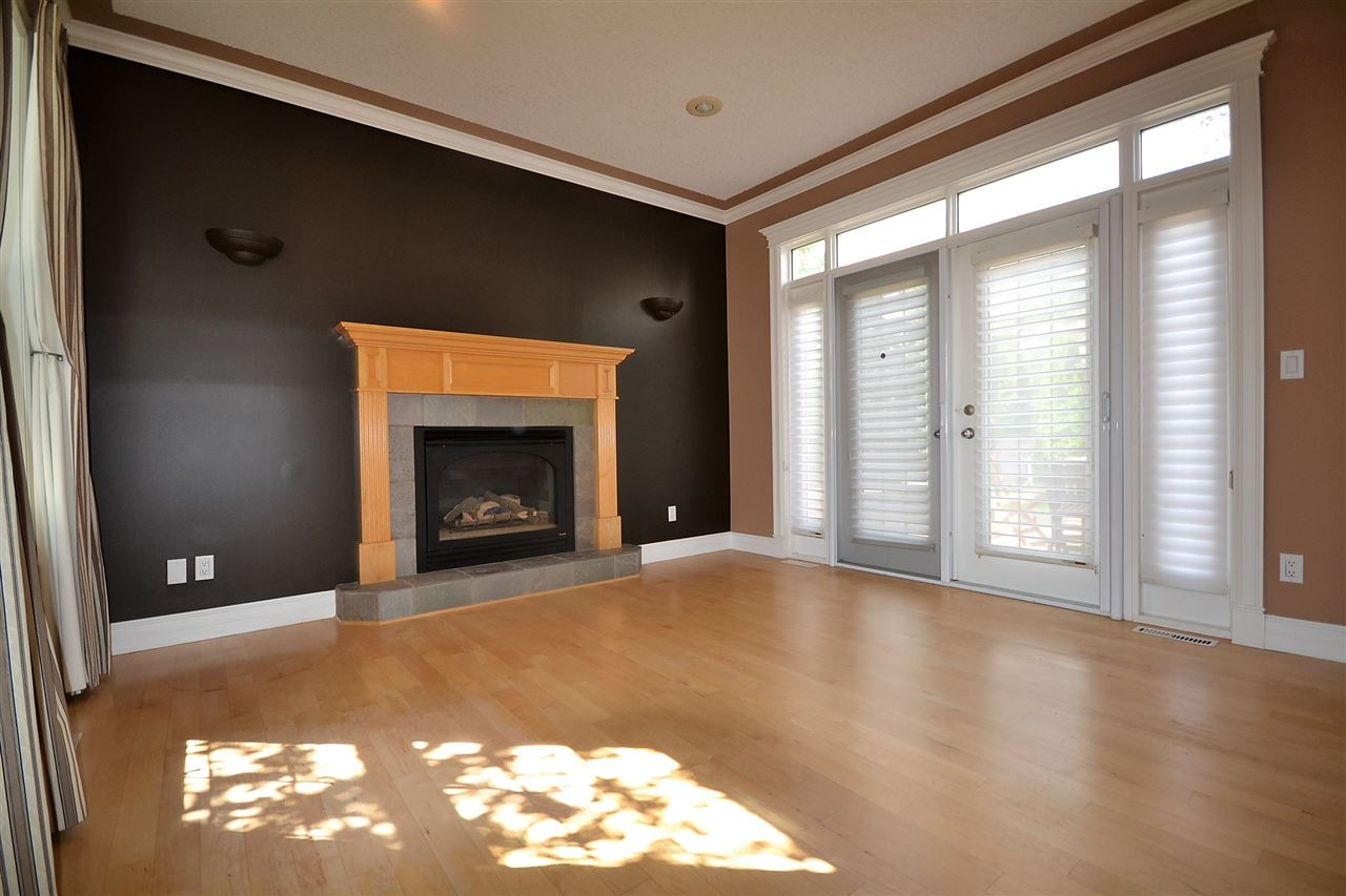 Gas fireplace. Hardwood floors. French doors to rear deck.