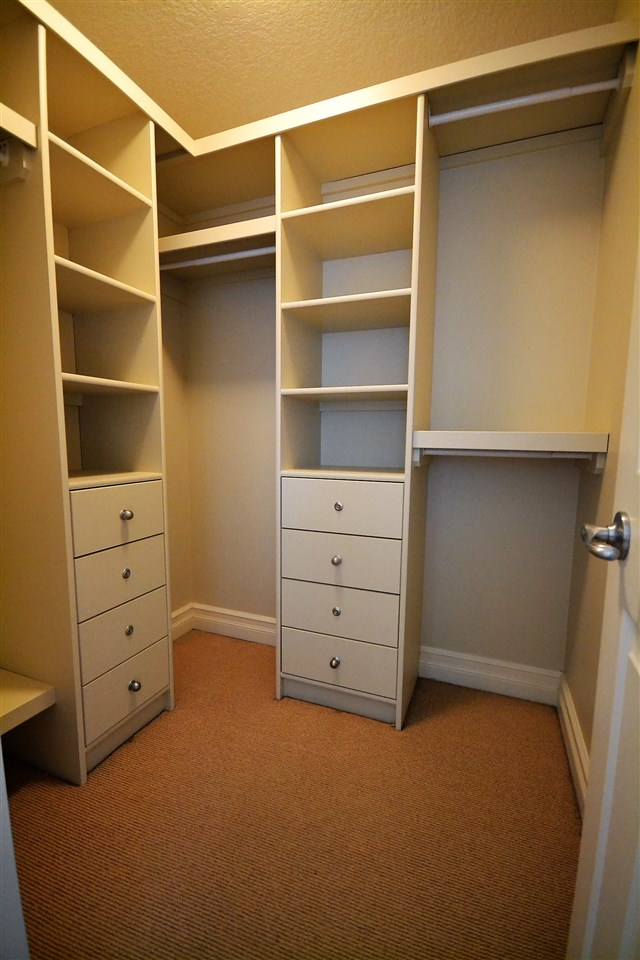 "This is one of ""two"" walk in closets, both with ""built ins"" in the Master bedroom."
