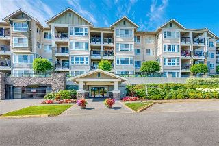 "Main Photo: 414 19673 MEADOW GARDENS Way in Pitt Meadows: North Meadows PI Condo for sale in ""FAIRWAYS"" : MLS® # R2211233"