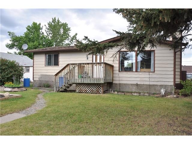 Main Photo: 214 Frontenac Avenue: Turner Valley House for sale : MLS® # C4070754