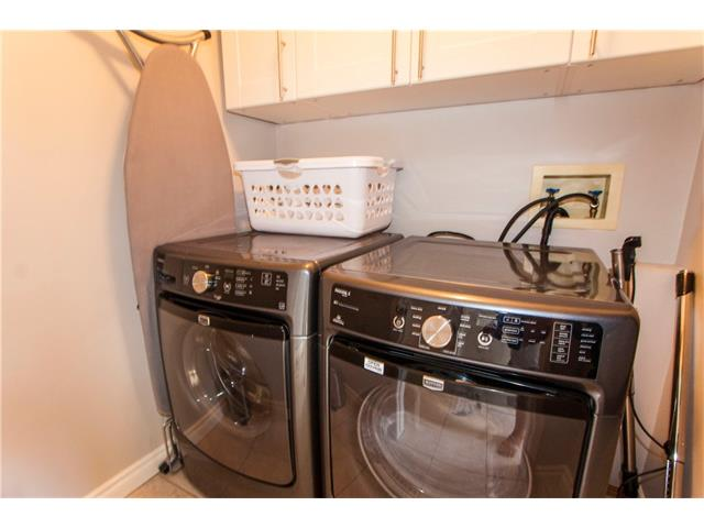 Laundry room with storage cabinets