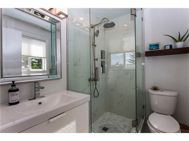 Completely renovated master ensuite with ceramic tile and large glass shower