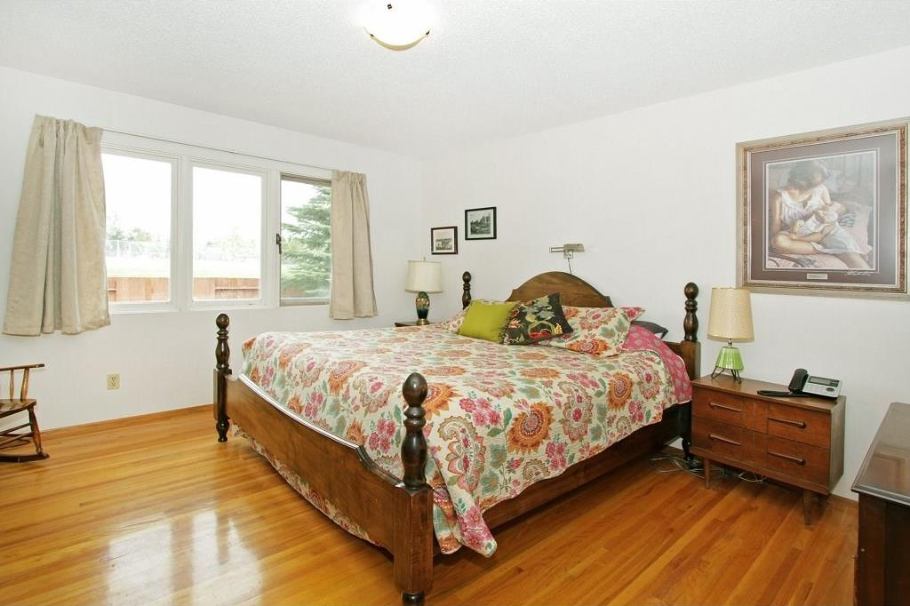 Master bedroom with ample room for King sized furniture and check out the condition of the hardwood floors on this main level.