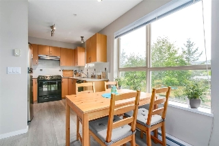 In addition to the formal dining area, there is a breakfast nook off of the kitchen for casual meals.