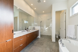 Master bathroom has a barrier free walk-in shower, separate water closet, large soaker tub and double sinks!