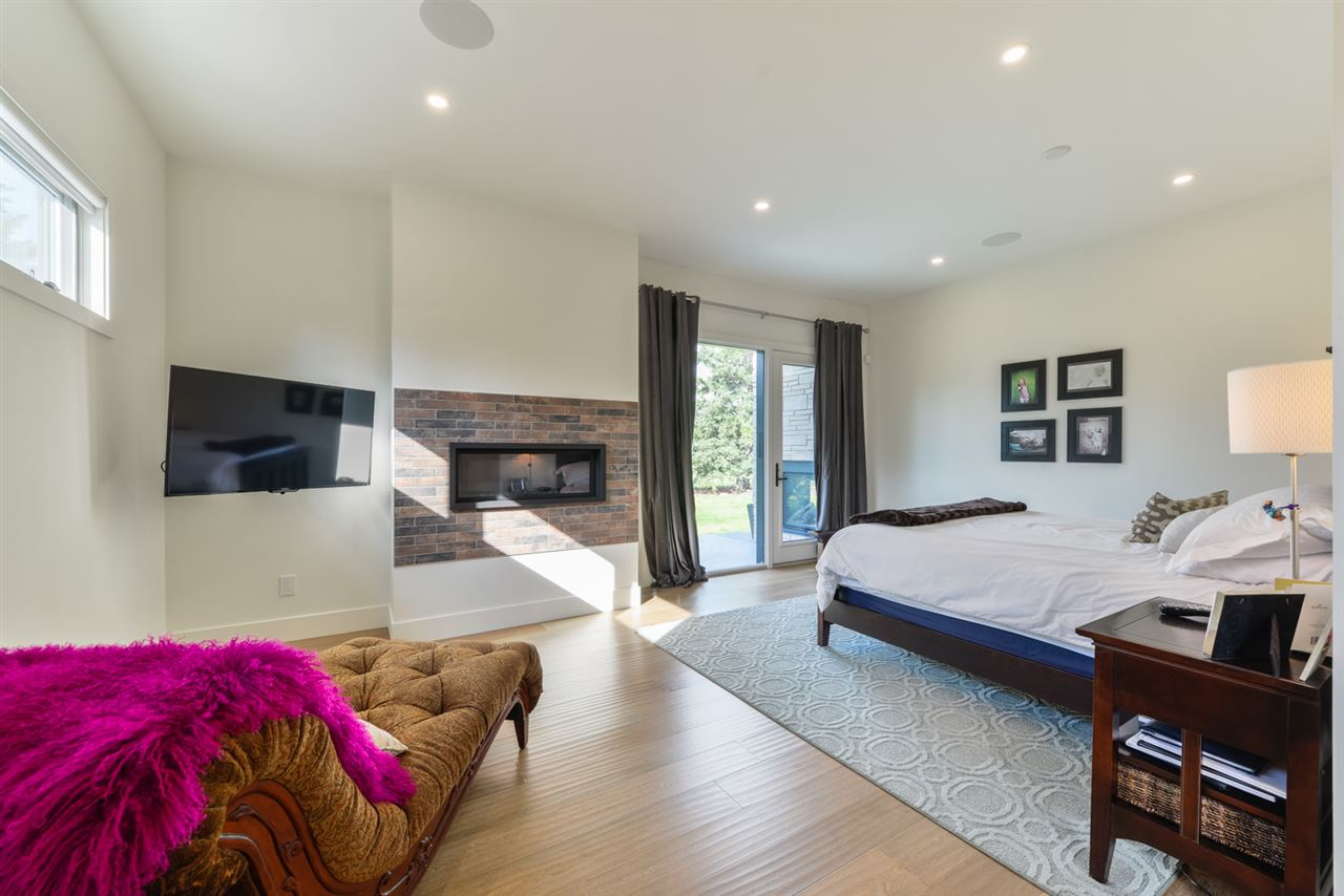 YOUR PRIVATE SANCTUARY! Large master bedroom with fireplace, access to deck, large walk-in closet and huge 5 piece ensuite with tub and walk-in shower.