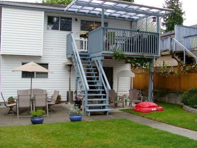 Exterior back with balcony and patio