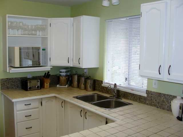 Kitchen with window above sink