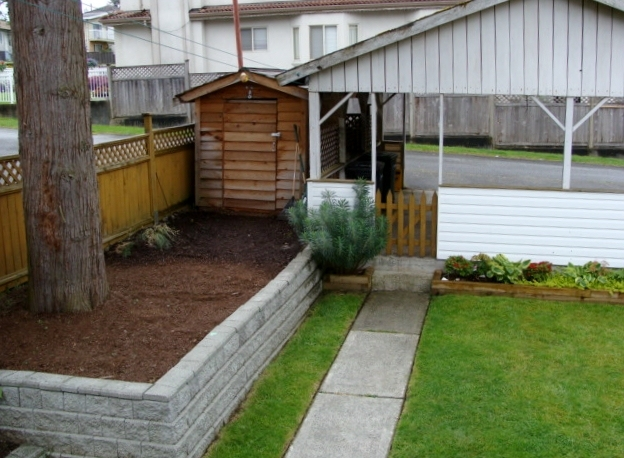 Backyard with shed and 2 vehicle carport