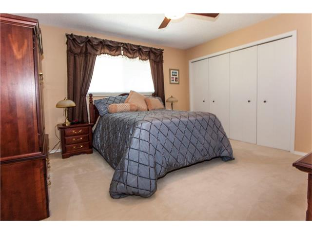 Master bedroom showing large his and hers closet