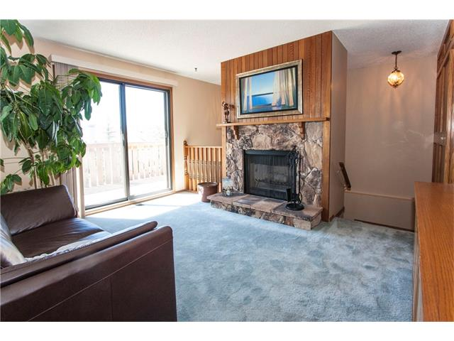 Stone Faced wood burning fireplace in living room