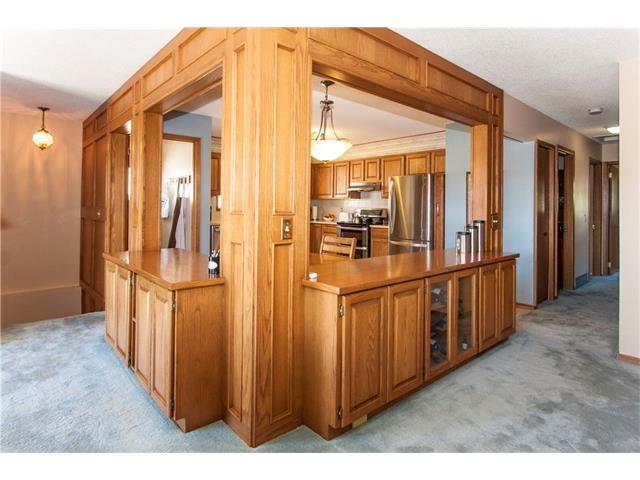 Unique built in and storage leading into large kitchen
