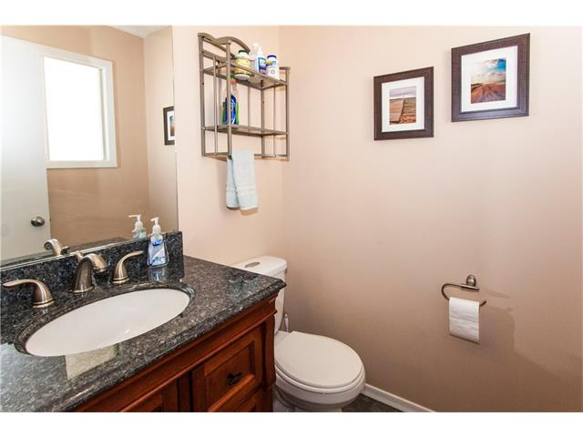 Upgraded ensuite with low flow toilet, granite countertops and tile floor