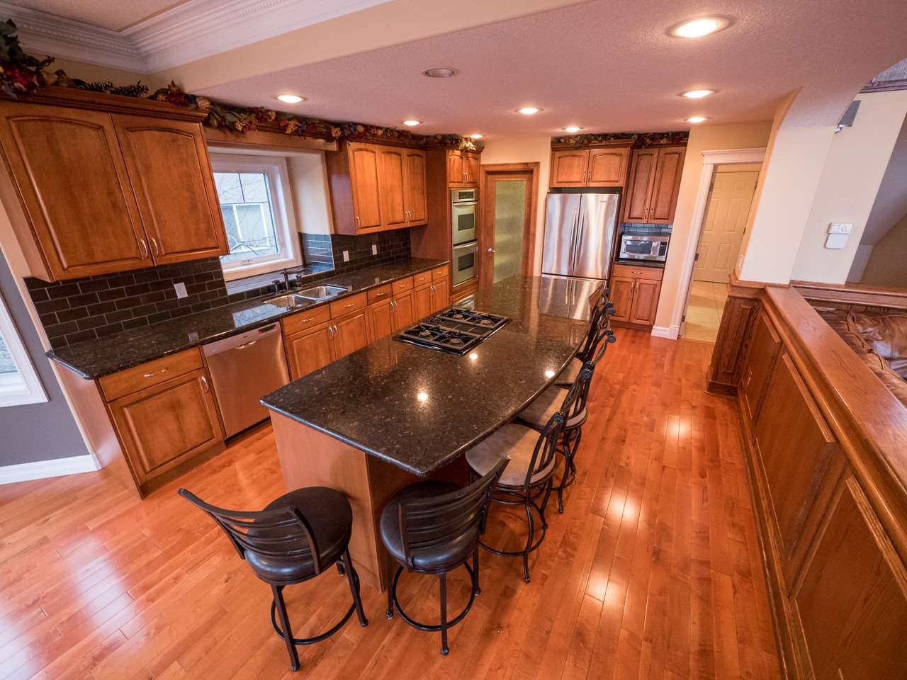 Spacious kitchen boasts lots of storage and a walk-through pantry.