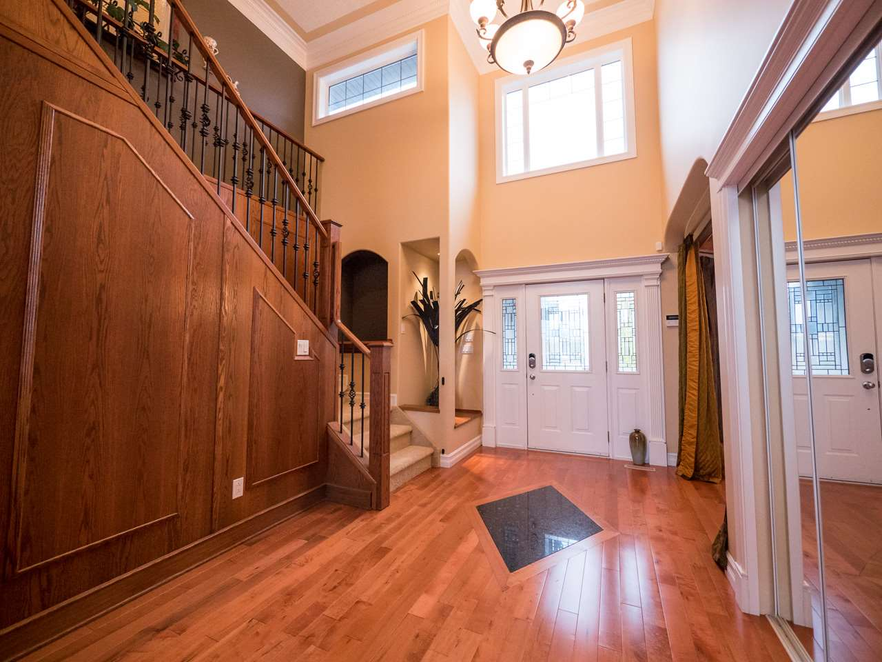 Spacious two storey foyer leads to the open concept main floor and upper level loft.