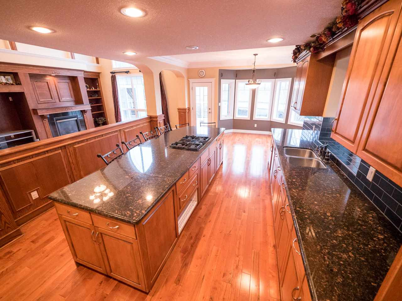 Chef's dream kitchen with maple cabinetry, granite countertops, stainless steel appliances & large center island is suitable for cooking and entertaining at the same time.