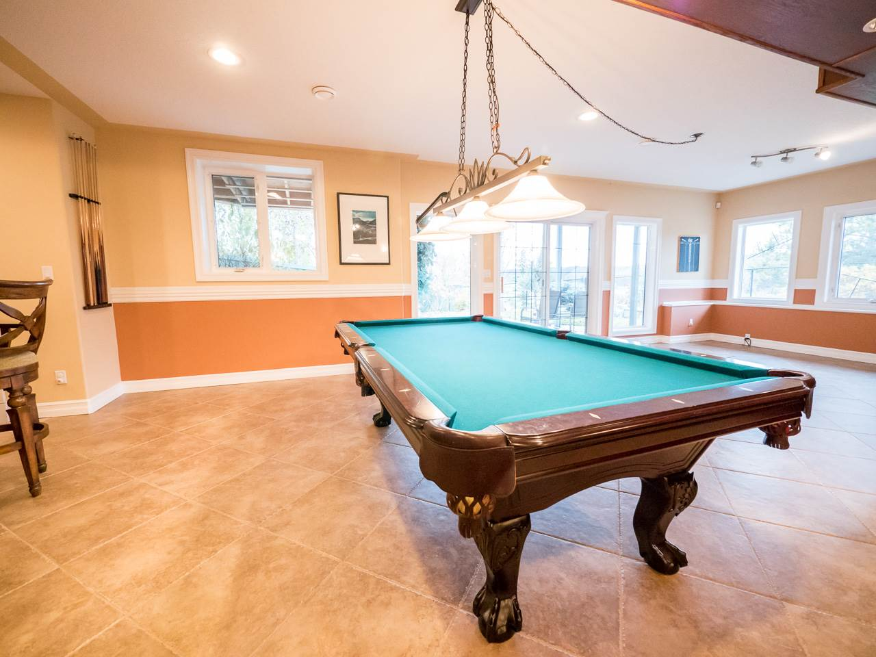 Spacious games room for family fun times.  Patio doors lead to the lower level patio great for summertime enjoyment.