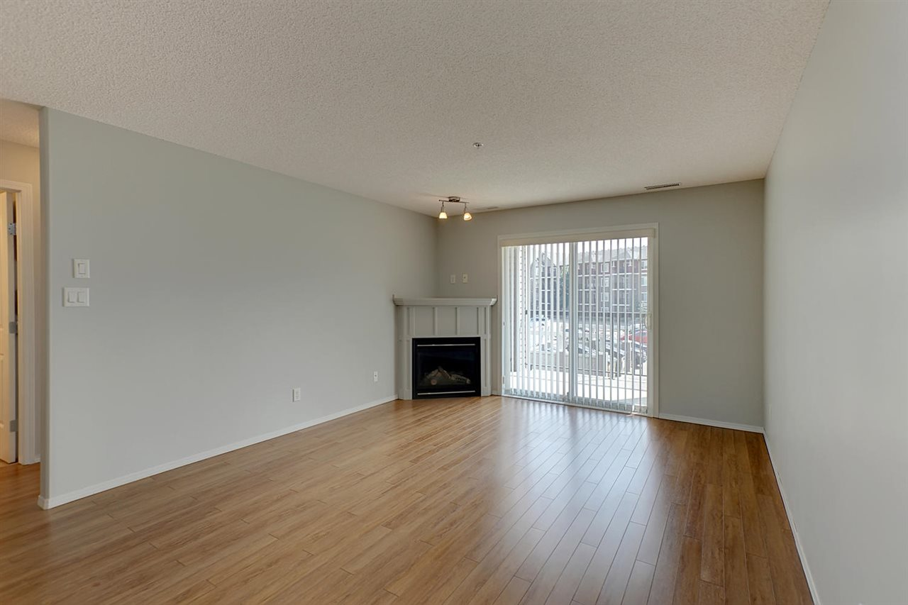 Nice large space with a corner gas fireplace and patio doors to your east facing balcony with gas BBQ outlet.