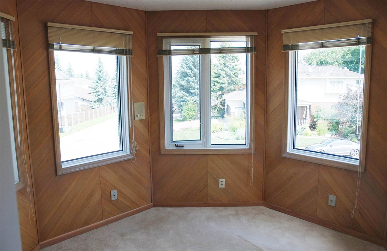 Bright cheery bonus room on upper level. Great for office or den.