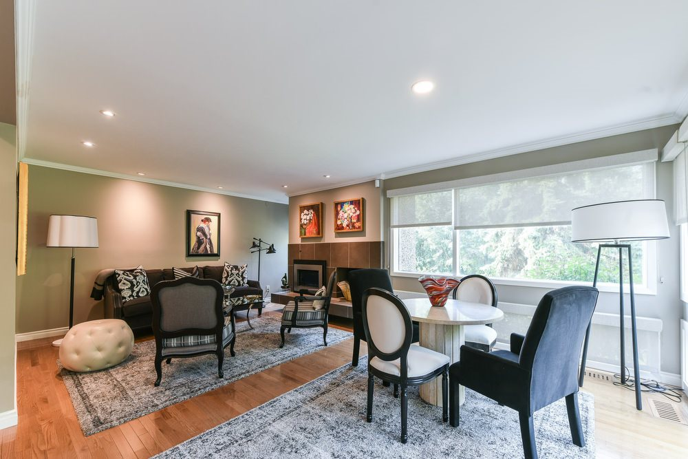 Features a gas fireplace with a view of the ravine & access to the large deck.