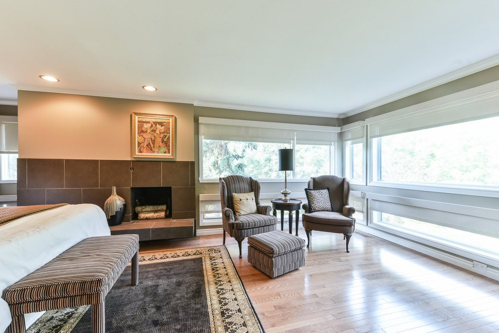With beautiful tile surround wood fireplace, floor-to-ceiling windows and a  4-piece ensuite.