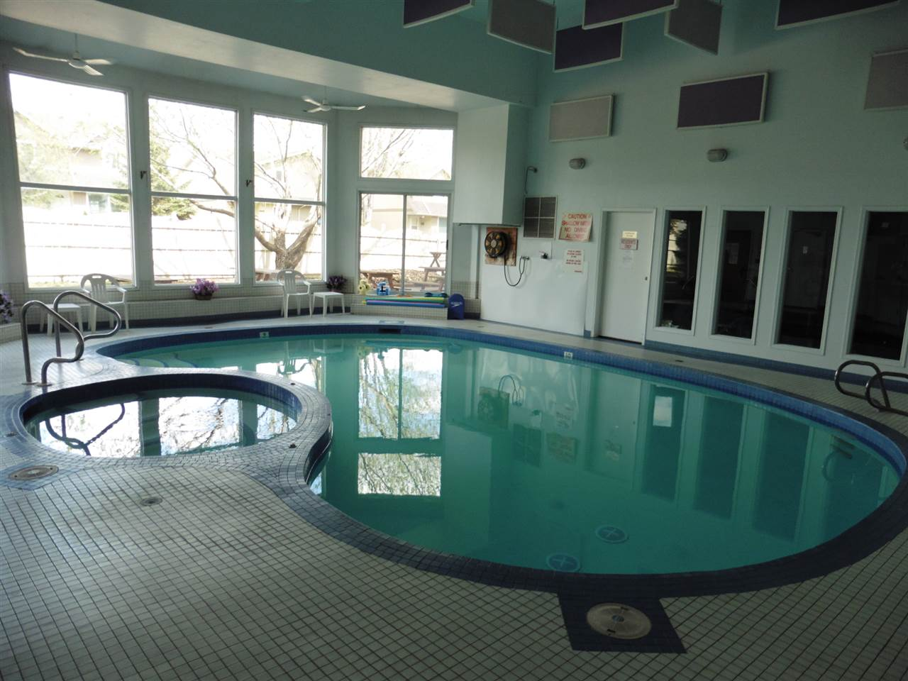 Lovely indoor swimming pool with hot tub and sauna.  Also a large patio area outside the pool area.