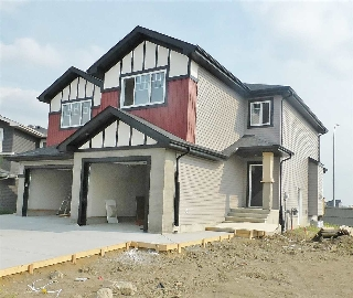 Main Photo: 17709 13 Avenue in Edmonton: Zone 56 House Half Duplex for sale : MLS(r) # E4067893