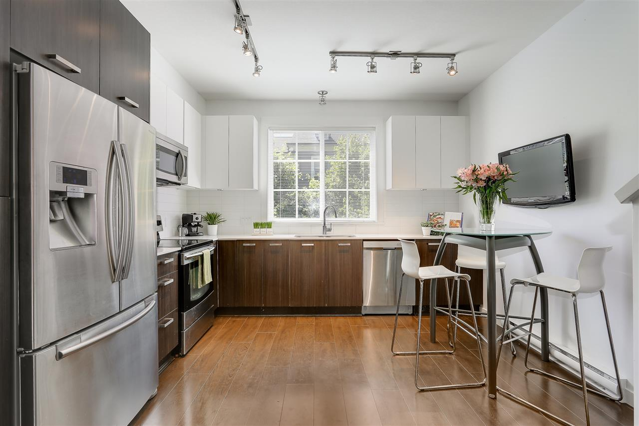 The open layout of the kitchen is great for families.  The window overlooks a garden area.  Stainless steel appliances including an upgraded extra large fridge.
