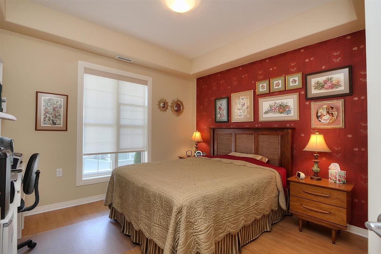 The Master bedroom has one focal point with the snazzy red wall. Show off your personal style if this matches you or if not, there is only one wall to paint. Laminate here also makes maintenance easy. The large low window opens onto your large balcony.