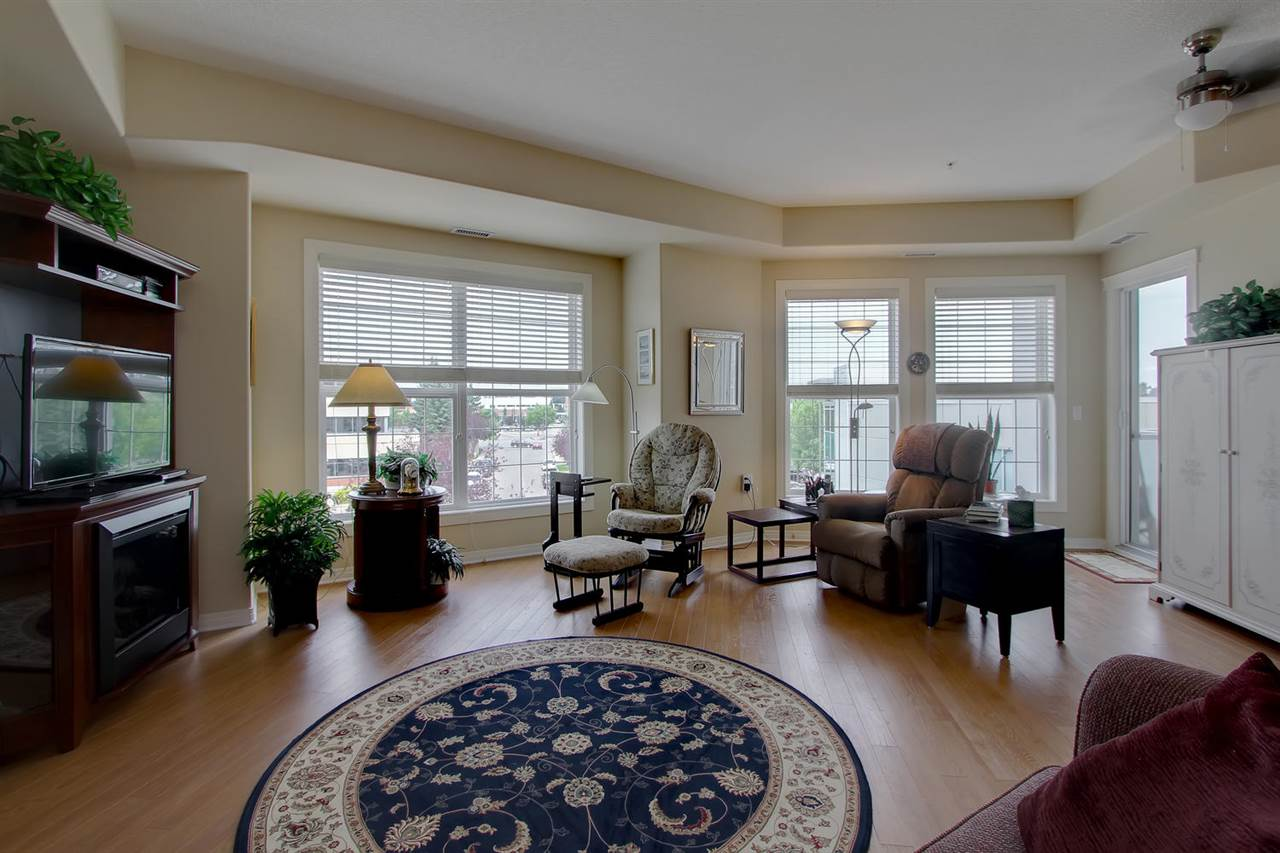 The great room style of this air conditioned condo  has a  wall of windows to add a light and bright open feeling. The 9 ft ceilings are another bonus. There is also a phantom screen door leading to the balcony for a nice breeze if you prefer.
