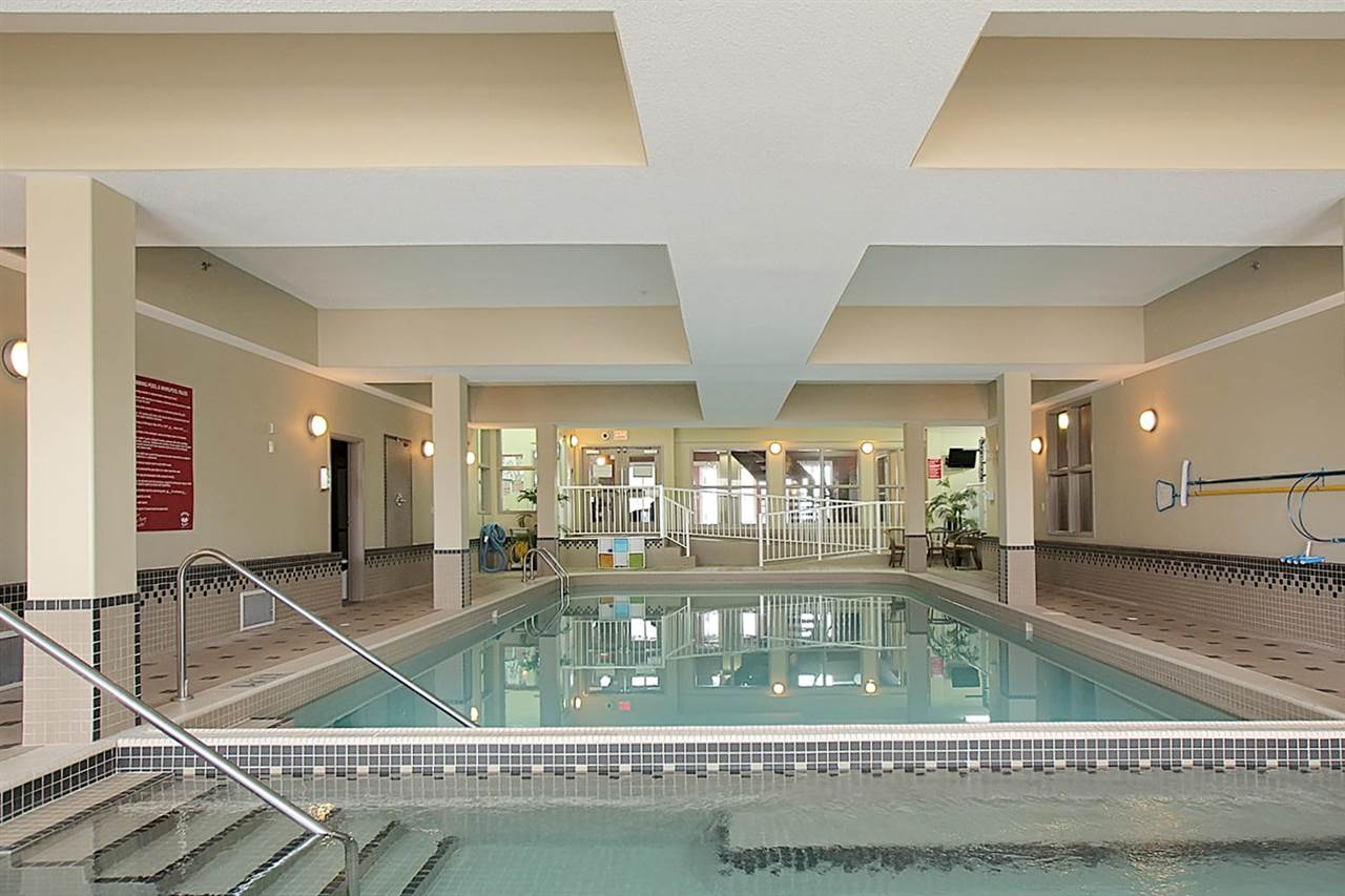 This large salt water pool and surrounding hot tub, steam room and exercise equipment can allow you to remain active. The grand kids will want to come visit you more often which is a huge bonus. This pool ready for you to enjoy. It's like a fitness club.